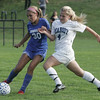 Danvers' Delaney Zecha is defended by Peabody's Amanda Nihan during Wedensday afternoon's game held in Peabody. Photo by Deborah parker/september 29, 2010