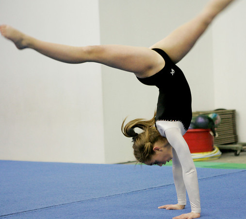 Salem: Bishop Fenwick's Diana Tauro performs her floor routine during the Crusader Inviational held at Baker's gym Friday night. Photo by Deborah Parker/Salem News Friday, January 30, 2009.