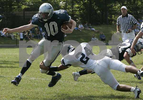 Hamilton: Hamilton Wenham's Andy Duval is tackled by Lynnfield's Gino Cohee during yesterday's game held at Hamilton-Wenham. Photo by Deborah Parker/Salem News Saturday, September 13, 2008