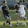 Hamilton:Hamilton's Kristen Brao keeps the ball away from Lynnfield's __ (no roster) during yesterday's game at Hamilton. <br /> Photo by Deborah Parker/Salem News Friday, October 24, 2008