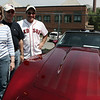 Salem: From left Connie and George Lowell of Peabody and Nick Barrasso of Nashua pose next to the Lowell's corvette during the Vettes for Pets event Saturday. The event was a fundraiser for Northeast Animal Shelter. and include Corvettes, street rods, classics and muscle cars along with music, food and raffles and a professional dog training demonstration<br /> Photo by Deborah Parker/May 16, 2009