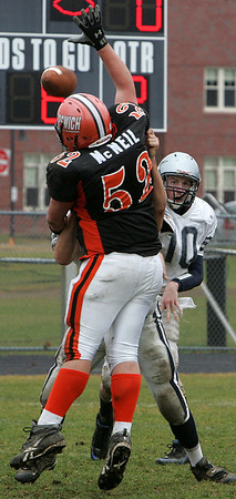 Ipswich's Bubba McNeil blocks the pass by Hamilton-Wenham's Andya Duval during their Thanksgiving football game held at Ipswich HIgh School. Photo by Deborah Parker/November 26, 2009