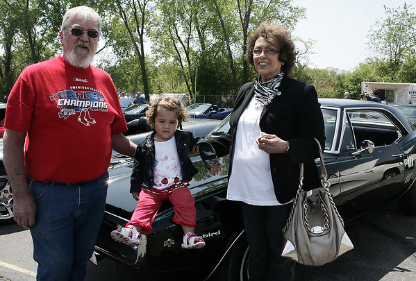 Salem: Whitey and Barbar Haynes of Middleton stand in front of Whitey's Firebird with their granddaguther Giah, 2, during the Vettes for Pets event Saturday. The event was a fundraiser for Northeast Animal Shelter. and include Corvettes, street rods, classics and muscle cars along with music, food and raffles and a professional dog training demonstration<br /> Photo by Deborah Parker/May 16, 2009