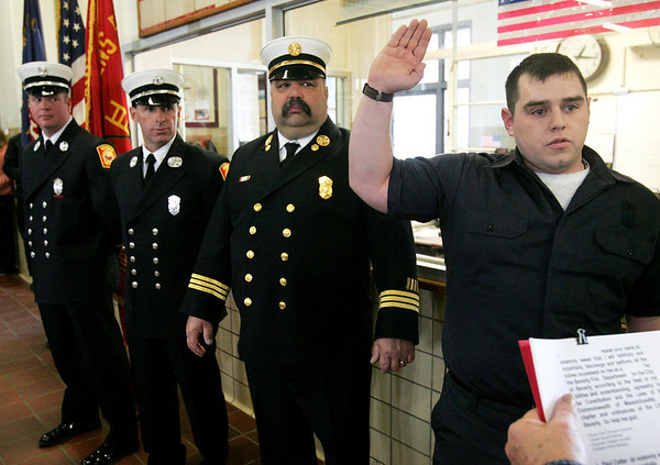 Firefighter Derek Belanger is sworn in as, newly promoted Leiutenant Matthew Kowalski, Captian Russell Halloran and Deputy Cheif Michael Acciavatti look on during a ceremony at Beverly Fire Headquarters Tuesday afternoon. Photo by Deborah Parker/February 2, 2010