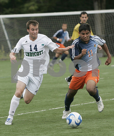 Beverly : Endicott's Ryan Coates and Salem State's Marcello Silva fight for control of the ball during yesterday's game held at Endicott College. Photo by Deborah Parker/Salem News Saturday, September 06, 2008