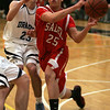 Salem's Raphy Medrano is defended by Dracut's Aaron Barbosa during last night's Division 2 North semi final game held at Woburn High School Photo by Deborah Parker/March 3, 2010