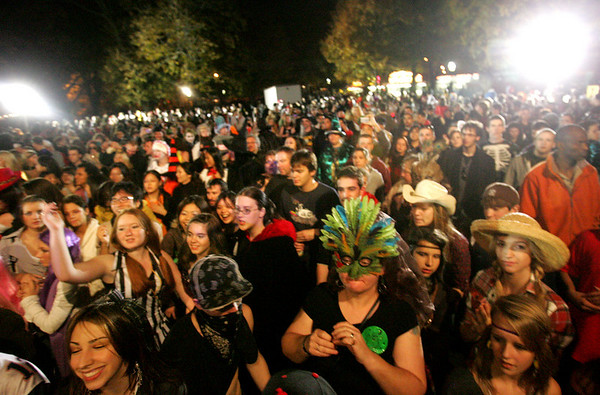 A large crowd gather at the Salem Common to dance to music supplied by a DJ Halloween evening. Photo by Deborah Parker/October 31, 2009