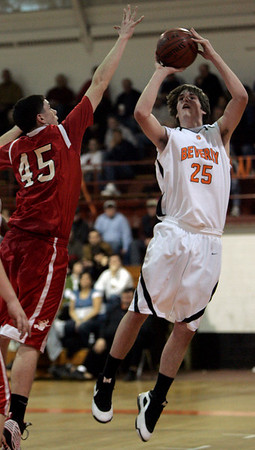Beverly: Beverly's Justin Resse is defended by Salem's Kyle Reardon in front of the net during last night's game at Beverly High School. Photo by Deborah Parker/Salem News Friday, February 13, 2009.