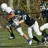 Hamilton: Pingree's Evan Perkins brings down Holderness' Jack Dings during Saturday's game at Pingree.<br /> Photo by Deborah Parker/Salem News Saturday, October 11, 2008