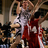 Danvers: St. John's Patrick Connaughton goes for a lay up against Catholic Memorial's Mike Ennis during yesterday's game held at St. John's. Photo by Deborah Parker/Salem News Friday, January 16, 2009.