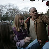 Cousins, from left, Kerry Reynolds, 11, of Georgetown, Meg McWhirter, 13, of Hamilton, along with their grandfather, John Washeba of Winthrop, hang ornaments on a tree as part of a Holiday Candlelight Service at Puritan Lawn Memorial Park in Peabody Sunday afternoon. photo by deborah parker/decemebr 5, 2010