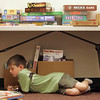 Nathaniel Mattera, 7, of Gloucester, found a quite place to read a book during the Hamilton-Wenham Public Library book sale for kids Wednesday morning. Photo by Deborah Parker/June 23, 2010