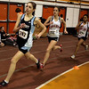 Beverly: From left, Peabody's Kristina Richard, and Salem's Marissa Osgood and Milly Canela compete in the 1 mile heat during their meet at Beverly High School Thursday evening. Photo by Deborah Parker/Salem News Thursday, January 22, 2009.
