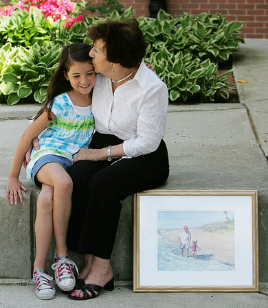 Julianne LeBlanc, 8, of Peabody, a second grader at Brown Elementary School sits with her grandmother Ruth Mowder. LeBlanc wrote a poem as part of an assignment in class and the poem won third place in a poety-art show. Her grandmother decided to create a painting based on her poem showing Julianne and her grandfather at the beach. Photo by Deborah Parker/May 6, 2010