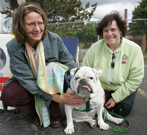 Reverand Annika Kleschinsky of Heartlight Peace Ministires of Swampscott poses with Sharon McGrath of Beverly and her bulldog Bugsy during the Northeast Animal Shelter's Blessing of the Animals event Saturday. Photo by Deborah Parker/October 10, 2009