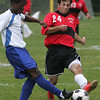Marblehead's Matt Frankel looks to block the pass of O'Bryant's Ibrahim Kallon during yesterday's game held at Marblehead High School. Photo by Deborah Parker/October 8, 2009