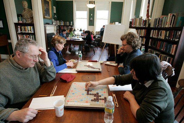 Salem: Rod Kessler, left, of Medford, concentrates as his opponent Margo Steiner sets up a word during the Scrabble Tournament at the Salem Athenaeum Saturday morning.  Both work at Salem State College and were having a scrabble face-off. The event is one of the many that took place over the weekend as part of the Literally Salem, Salem Literature Festival. Behind Kessler and Steiner are Joe McGuire of Salem and Jura Strimaitis of Swampscott. Photo by Deborah Parker/Salem News Saturday, March 28, 2009.