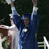 Edward Bates celebrates after receiving his diploma at Danvers High School's graduation ceremony Saturday afternoon. Photo by Deborah Parker/June 6, 2009