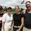 From left Elizabeth Buonopane, Jane Mastrometto, Kandi Kukas and John Doherty all of Peabody pose for a picture while cheering on the Athletics and Diamondbacks during their Little League game at Cy Tenney Park Sunday afternoon. Photo by Deborah Parker/May 31, 2009