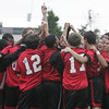 The Salem boys varsity soccer team gives off a cheer together before the start of their rainy game against Beverly held in Beverly Tuesday afternoon. Photo by deborah parker/september 28, 2010