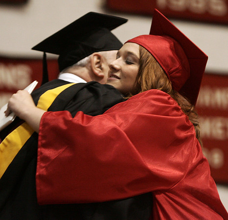 Emily Darisse gives her dad, Mark, a hug after receiving her diploma during Friday night's ceremony at Salem High School. Photo by Deborah Parker/ June 5, 2009