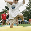 Foster Adams, 3, of Beverly takes a big leap over an obstacle course, partof Tiny Tots Day at Lynch Park on Sunday. Photo by Deborah Parker/August 2, 2009
