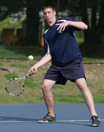 St. John's Prep's John Corvi competes in yesterday's match against St. Marblehead held in Danvers. Photo by Deborah Parker/May 11, 2010
