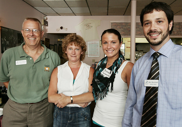 From left, Rinus Oosthoek, executive director of the Salem Chamber of Commerce, Bonnie Hurd Smith, a Salem business owner, Christine Simoncini, an intern at Salem Main Streets and Ben Bouchard, assistant director of the Salem Chamber of Commerce, attend Chamber After Hours, a Salem Chamber of Commerce networking event held at Caffe Graziani Thursday evening. Photo by Deborah Parker/August 20, 2009