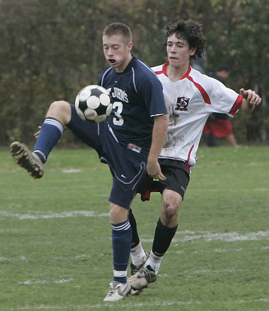 Salem: St. John's Prep's Sean Callahan keeps the ball from Salem's Mike Shea in yesterday's MIAA tournament action at Bertram Field. St. John's won the game 3-1. Photo by Deborah Parker/Salem News Friday, November 07, 2008