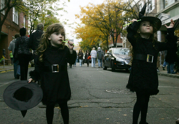 Sophia Putney, 4, left, and her sister Livia, of Framingham dressed as witches to walk the streets of Salem Saturday evening. Photo by Deborah Parker/October 31, 2009