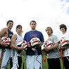 "Eli Hayward, center, a senior and captian of the Ipswich lacrosse team, organized an effort to put the intials ""JF"" on the team helmets this year in honor of classmate Jason Foster. Foster was killedin a car accidnet over the summer. Hayward did not know Foster well, but the lacrosse player felt the need to pay tribute to his classmate. Behind Hayward from left are teammates, Ben Michael, Eric Glanis, James Riel, Kenny Wing, Matt Ledbury and Jared French. Photo by deborah Parker/APril 12, 2010<br /> , Eli Hayward, center, a senior and captian of the Ipswich lacrosse team, organized an effort to put the intials ""JF"" on the team helmets this year in honor of classmate Jason Foster. Foster was killedin a car accidnet over the summer. Hayward did not know Foster well, but the lacrosse player felt the need to pay tribute to his classmate. Behind Hayward from left are teammates, Ben Michael, Eric Glanis, James Riel, Kenny Wing, Matt Ledbury and Jared French. Photo by deborah Parker/APril 12, 2010"