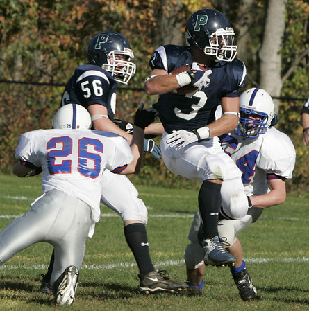 Hamilton: Pingree's Derek Pratt jumps through two Holderness defenders during Saturday's game at Pingree.<br /> Photo by Deborah Parker/Salem News Saturday, October 11, 2008