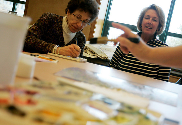 Peabody: From left, Janet Cohen of Peabody and Susan Purrell of Hamilton watch as Paula Kulas, a water color painter and teacher from Peabody, gives a lesson on water color painting at the Peter A. Torigian Community Life Center Thursday afternoon. The class just started a six week session on how to paint a snowy winter scene. Photo by Deborah Parker/Salem News Thursday, February 5, 2009.
