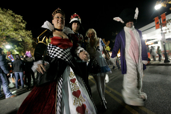 Salem: From left, Victoria and Lee Malo, Stephanie Ruocco and John Cosentino, all of Salem are stop by many onlookers as they walk down Derby Street Halloween night dressed as characters from Alice in Wonderland. Photo by Deborah Parker/Salem News Friday, October 31, 2008.