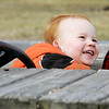Jude Gelwick, 2, of Beverly smiles up at his dad, Jay,  while playing at the playground at Dane Street Beach yesterday afternoon. Photo by Deborah Parker/ March 2, 2010