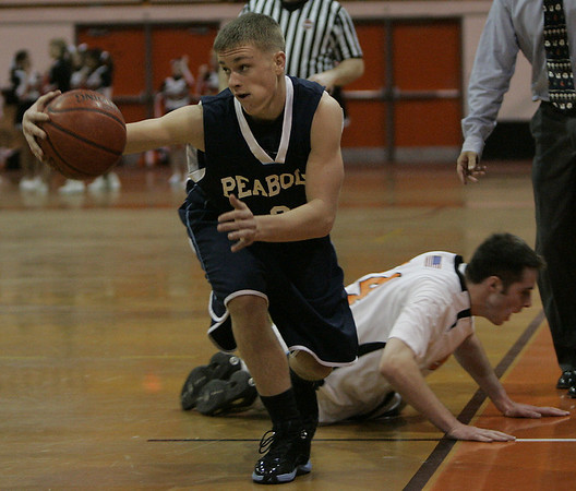 Beverly : Peabody's Mike Kerwin keeps the ball from going out of bounds during their game at Bevery Friday evening. Photo by Deborah Parker/Salem News Friday, December 12, 2008