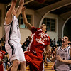 Danvers: St. John's Patrick Connaughton celebtraes after teammate Ryan Canty makes a slam dunk against Catholic Memorial's Bomani Simmonds-Jennings during yesterday's game held at St. John's. Photo by Deborah Parker/Salem News Friday, January 16, 2009.