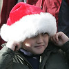 Marblehead: Charlie Clifford, 7, of Marblehead holds his fingers to his ears as a fire truck passed down Washington Street  in the Christmas parade Saturday. Photo by Deborah Parker/Salem News Saturday, December 06, 2008