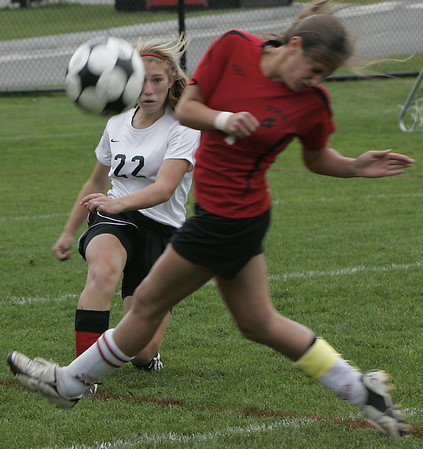 Marblehead:Marblehead's Gabrielle Carrick kicks the ball past Salem's Monique Gallant during yesterday's game at Marblehead.<br /> Photo by Deborah Parker/Salem News Friday, October 03, 2008