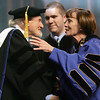 Salem State President Patricia Maguire Meservey congratulates Robert Lappin after he received an honorary degree from the College during the graduate studies graduation ceremony Thursday afternoon. Photo by Deborah parker/May 20, 2010