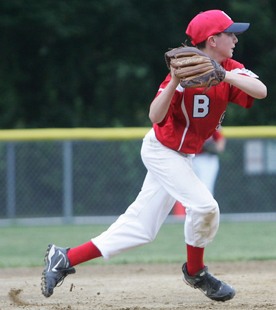 Boxford's Collin McCaughey throws to first against Manchester Essex during yesterday's Williamsport tournament game held at Moulton Field in Danvers. Photo by Deborah Parker/June 29, 2010