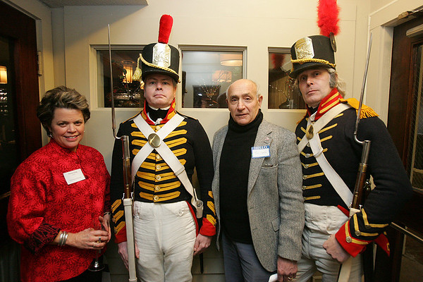 Francie King, the President of the Board of Trustees of the Salem Athenaeum and her husband Bob Erbetta, pose for a picture with Zach Woods and Mark Hilliard of the 1812 Marine and Navy Guard while attending a cocktail reception at Sixty2 on the Wharf to kick off the bicentennial year of the Salem Athenaeum. Photo by Deborah Parker/January 12, 2009.
