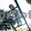 Hamilton: Edward Dong, 5, of Malden giggles as he makes his way down the jungle gym while playing at Patton Park Sunday morning with his family.<br /> Photo by Deborah Parker/Salem News Sunday, September 07, 2008