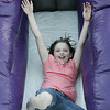 Madison Suchecki, 8, of Salem, throws her hands up in the air while going down a slide during Kid's Night at the Salem Commons, part of Salem Heritage Days. Photo by Deborah Parker/August 7, 2009