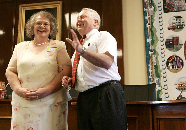 Beverly mayor Bill Scanlon jokes with Linda Giallongo, his former secretary, during a retirement party held at City Hall Thursday afternoon for 14 city employees who took voluntary early retirement as a way for the city to save money. Photo by Deborah Parker/June 25, 2009.