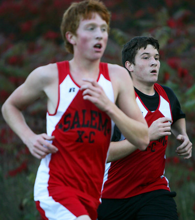 Jeff Turben runs along teammate Cole Smith during yesterday's meet against Revere held at Gallows Hill Park in Salem. Photo by Deborah Parker/October 6, 2009