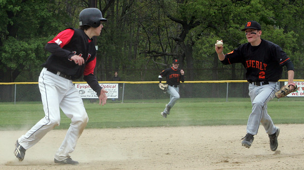 Beverly's Steve Wilbur looks to tag Marblehead's Jake Kulevich at third base during yesterday's game held at Cooney Field in Beverly. Photo by Deborah Parker/May 12, 2010