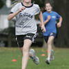 Meghan Carney, a sixth grade student at St. John's of Peabody, runs to the finish line to beat Mary O'Brien of St. Mary's of Melrose during their cross country meet held at Emerson Park in Peabody Thursday afternoon. Photo by deborah parker/october 14, 2010