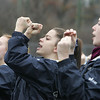 Members of the Hamilton-Wenham Cheerleading squad root for their team during the  Thanksgiving football game against Ipswich. Photo by Deborah Parker/November 26, 2009