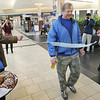 "Johnny Wowk of Peabody, also known as ""Johnny the Walker"", was celebrated at the North Shore Mall after reaching the  20,000 mile mark. He's been walking daily for years. Photo by Deborah Parker/February 12, 2010"